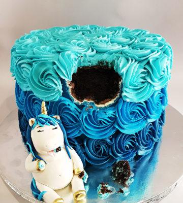 fat unicorn eating cake